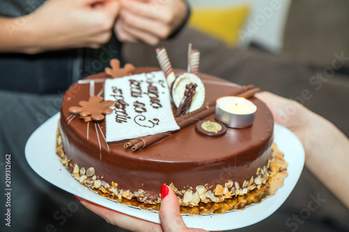 Young Woman Holding Plate With Tasty Birthday Cake