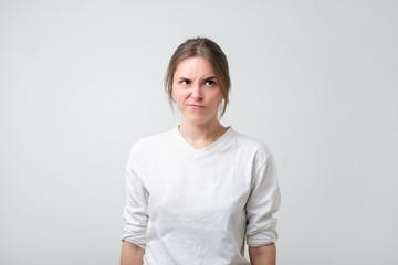 Portrait of an upset unsatisfied european woman.