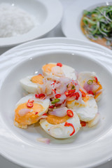 Salted eggs salad in white plate and selective focus.
