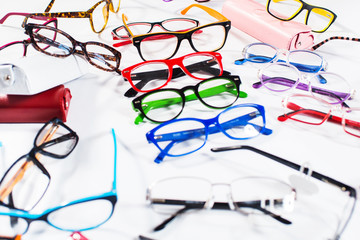 Set of many different colored glasses on white background