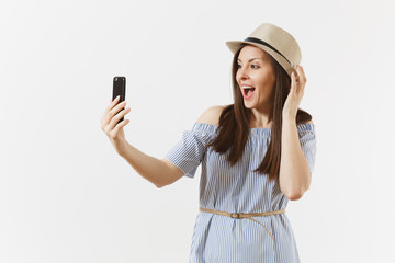Young beautiful woman dressed blue dress, hat doing selfie shot on mobile phone or video call isolated on white background. People, sincere emotions, lifestyle concept. Advertising area. Copy space.