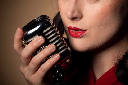 Vintage female singer with microphone