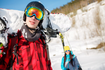 Portrait of sports man wearing helmet with snowboard