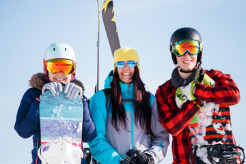 Picture of sports women and men with snowboard on vacation