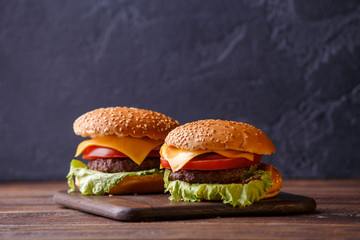 Picture of two hamburgers on wooden table
