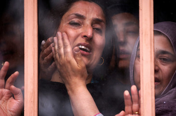 "Wife  of Syed Shujaat Bukhari, the editor-in-chief of local newspaper ""Rising Kashmir"", who according to local media was killed by unidentified gunmen outside his office in Srinagar, mourns during his funeral in Kreeri"