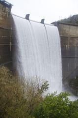 Dam unloading water