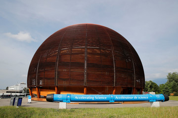 The Globe of Science exhibition hall and a magnet are pictured before a news conference to launch the works for the High Luminosity LHC Project  at the CERN in Meyrin