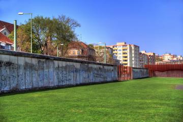The remnants of Berlin Wall near Bernauer Strasse on blue sky