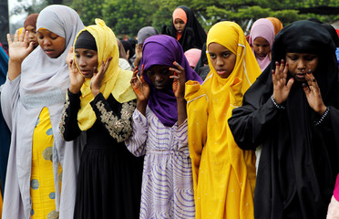 Muslims attend Eid al-Fitr prayers to mark the end of the holy fasting month of Ramadan at the Sir Ali Muslim Club Ground in Nairobi, Kenya