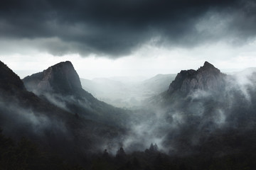Dramatic weather on Sanadoire and Tuilière rocks in Auvergne province - France