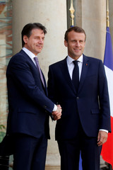 French President Emmanuel Macron welcomes Italian Prime Minister Giuseppe Conte as he arrives for a meeting at the Elysee Palace in Paris