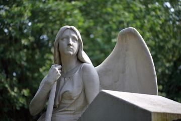 Cemetery sculpture Angel sitting