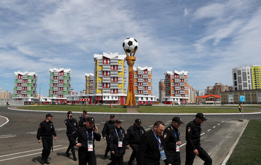 Security officers walk outside the Mordovia Arena in Saransk