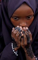 A Muslim woman participates in Eid al-Fitr prayers to mark the end of the holy fasting month of Ramadan at the Sir Ali Muslim Club Ground in Nairobi