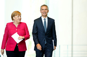 Germany's Merkel meets NATO Secretary-General Jens Stoltenberg