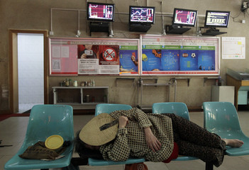 An investor takes a nap at a brokerage house in Wuhan