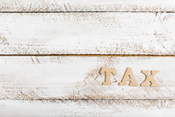 Tax word on white painted table