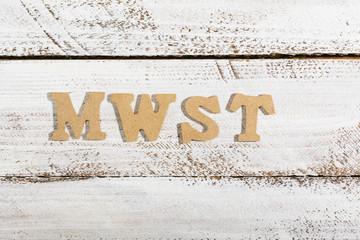 MWSt (German VAT) word on white painted table