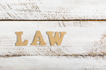 Law word on white painted table