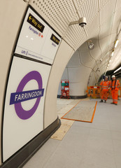 Crossrail workers are seen in the new Farringdon underground station of the Elizabeth line which opens in December 2018, in London