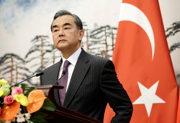 Chinese Foreign Minister Wang Yi attends a joint news conference with Turkish Foreign Minister Mevlut Cavusoglu in Beijing
