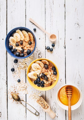 Oat porridge with banana and blueberries, healthy morning nutrition meal
