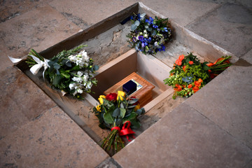 Flowers are placed alongside the ashes of British scientist Stephen Hawking at the site of interment in the nave of the Abbey church, during a memorial service at Westminster Abbey, in London