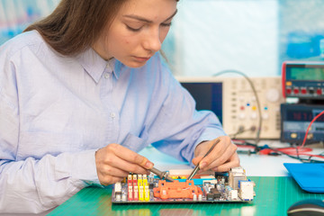 girl student in the class physics and electronics