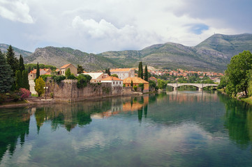 Picturesque landscape with mountains and  ancient city on the banks of the river.  Bosnia and Herzegovina, view of Trebisnjica river  and Old Town of Trebinje