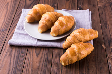 Freshly baked butter croissant. Closeup