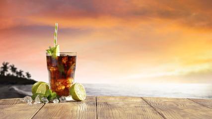 Deurstickers Cocktail fresh cold summer drink and golden sunset time