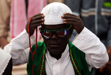 A Muslim attends Eid al-Fitr prayers to mark the end of the holy fasting month of Ramadan in Addis Ababa