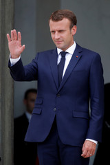 French President Emmanuel Macron waves to Italian Prime Minister Giuseppe Conte as he leaves after a meeting at the Elysee Palace in Paris