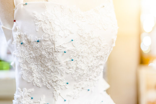 beautiful wedding dress decorated with flower patterns