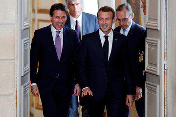 French President Emmanuel Macron and Italian Prime Minister Giuseppe Conte arrive for a joint news conference at the Elysee Palace in Paris