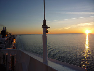 Cruise ship at sea with sunset