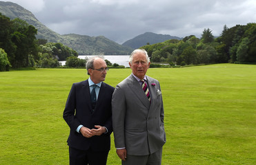 Britain's Prince Charles and Philip Buckley, Head of National Parks, look out on to the lakes in the grounds of Muckross House in Killarney