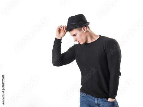 e3297c844f7c9 Handsome young muscular man looking down in studio shot