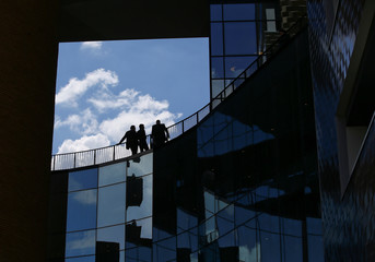 People are seen on a balcony at the headquarters of the BNL (BNP Group Paribas) bank in Rome