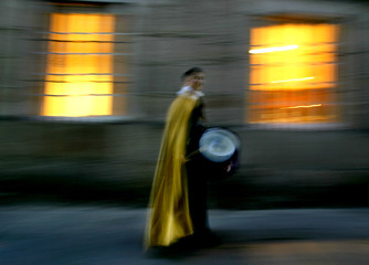 A penitent heads to take part in a Holy Week procession in the northern Spanish town of Pontevedra.
