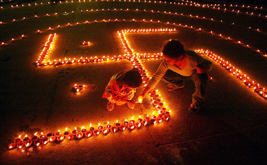 Children light lamps in the shape of Swastika in Chandigarh.
