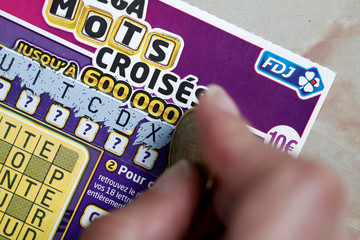 A scratch card from the French lottery company Francaise des Jeux (FDJ) is seen in this picture illustration