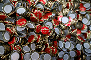 Caps for bottles of beer are seen at the Birra Peroni beer factory in Rome