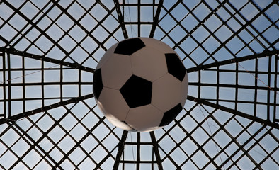 A giant soccer ball hangs from the roof inside a shopping mall next to the Red Square in central Moscow