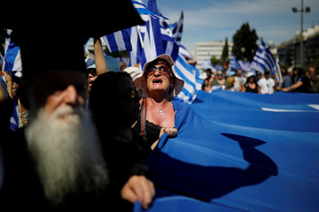 Protesters demonstrate against the agreement reached by Greece and Macedonia to resolve a dispute over the former Yugoslav republic's name, in Athens