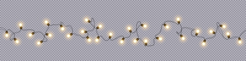 Christmas and New Year garlands with glowing light bulbs Wall mural