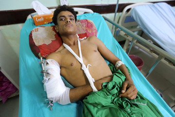 Man lies on a hospital bed after he was inured by clashes between government forces and Houthi fighters near Hodeidah