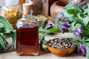 Comfrey tincture with dried comfrey root and fresh plant