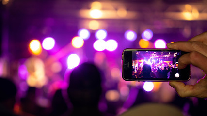People holding their smart phones and photographing concert. Open air Rock Festival in Germany